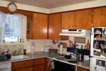 before kitchen with wood cabinets