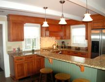 kitchen with wood cabinets & green island