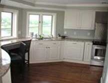 kitchen with white cabinets & blue wall