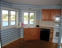 kitchen with blue plaid wallpaper