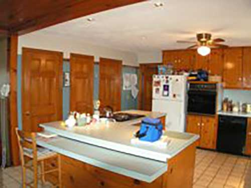 brown kitchen with blue walls