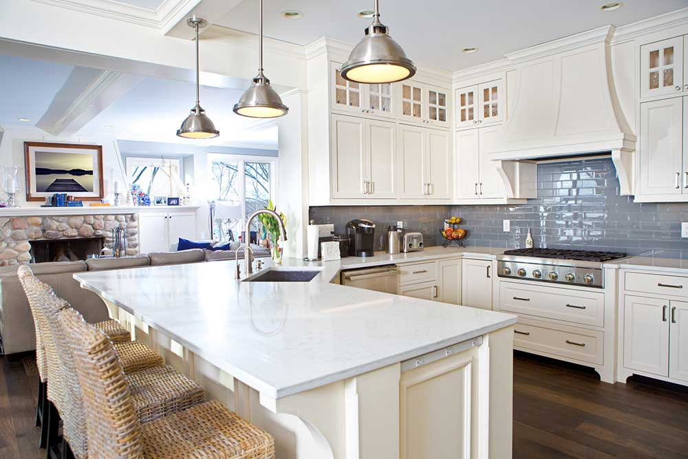white kitchen with blue backsplash & walls