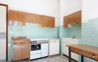 Old kitchen interior with turquoise tiles