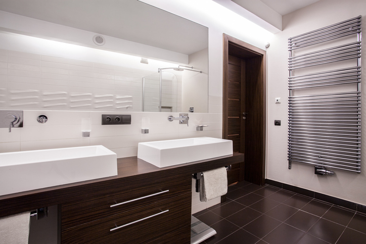 bathroom with large mirror & towel warmer