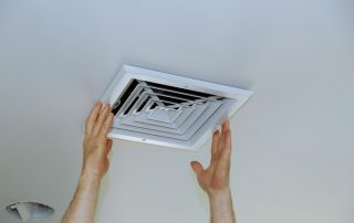 person installing air vent